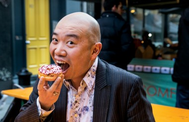 Dr Giles Yeo eating a donut