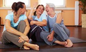 Women laughing in yoga class
