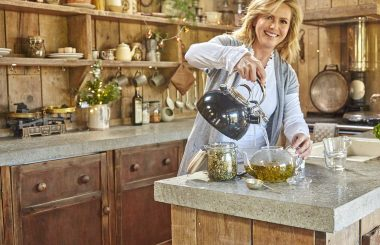 Liz pouring loose leaf tea