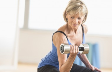 mid life woman exercising lifting weights, bone health