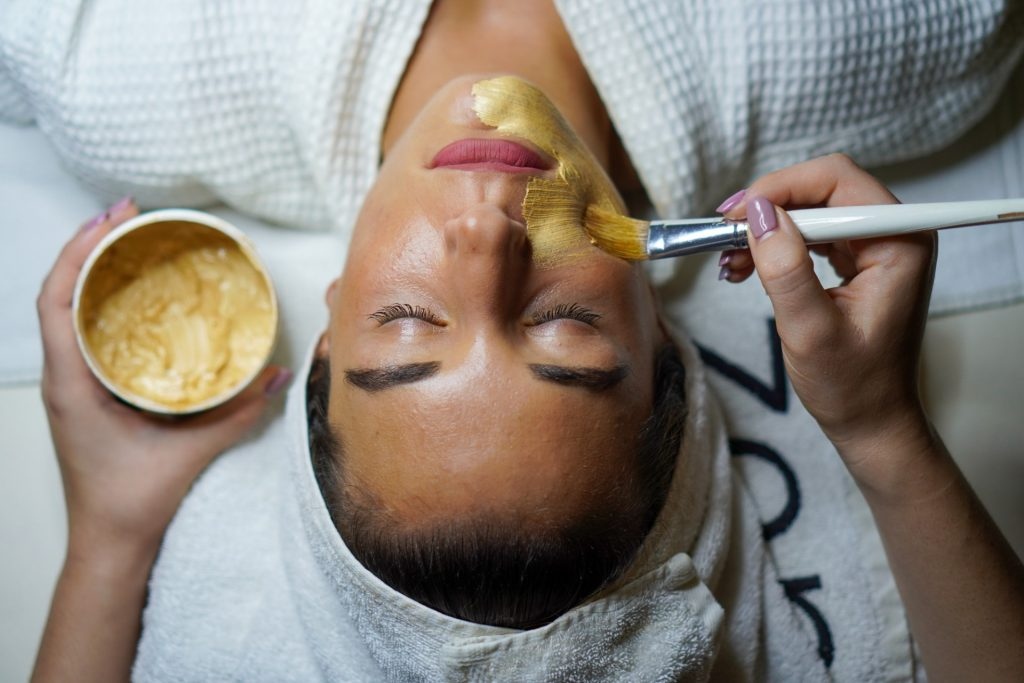 Woman enjoying gold face mask