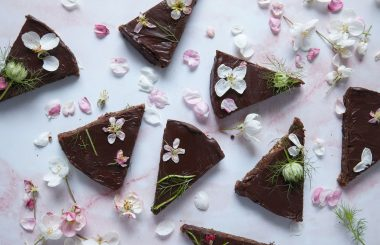 Raw chocolate slices with edible flowers